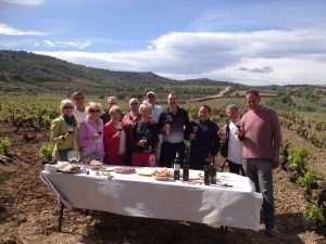 Group of visitors tasting wine out in the vineyards in Rioja