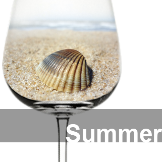 Wine glass with sand and a shell