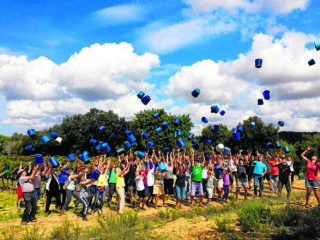 Can Majoral, Majorca winery's grape harvesters celebrate the end of their work by throwing their buckets high into the air all at once